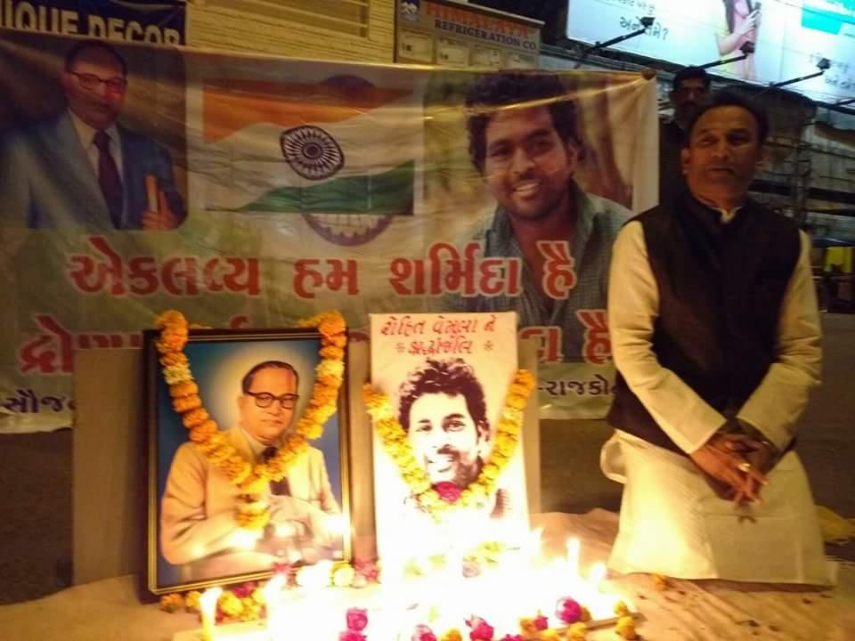 Sunil Jadhav next to portraits of Ambedkar and Rohith Vemula. Credit: Facebook