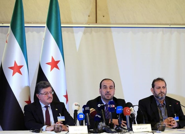 (L-R) Salim al-Muslat, Nasr al-Hariri and Fateh Hassoun members of the Syrian High Negotiations Committee (HNC) opposition group address the media aside of the Intra-Syria peace talks in Geneva, Switzerland, February 25, 2017. Credit: Reuters