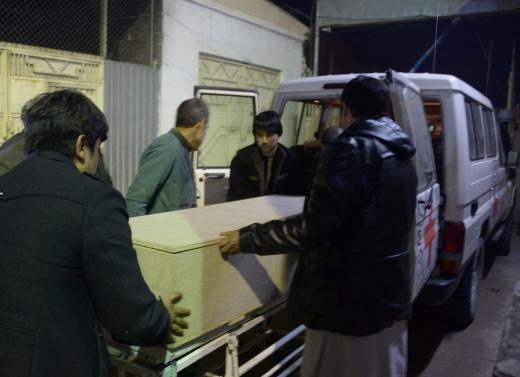 Afghan men unload a coffin of an International Committee of the Red Cross (ICRC) employee, who was killed by gunmen in Jwzjan province, at a hospital in Mazar-i-Sharif, Afghanistan February 8, 2017. Credit: Reuters