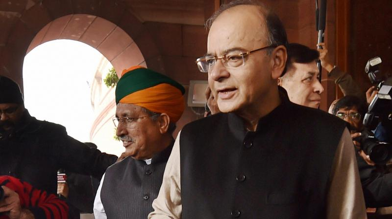 Finance minister Arun Jaitley arriving in parliament before the Budget presentation. Credit: PTI