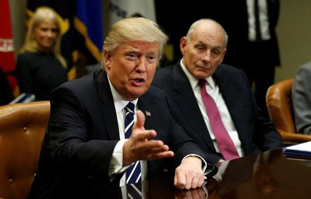 Homeland security secretary John Kelly (R) listens to US President Donald Trump during a meeting with cyber security experts in the Roosevelt room of the White House in Washington January 31, 2017. Credit: Reuters