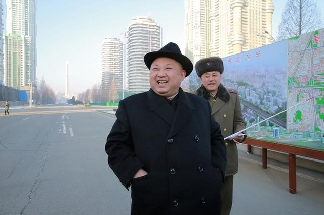 North Korean leader Kim Jong Un inspects the construction site of Ryomyong Street in this undated