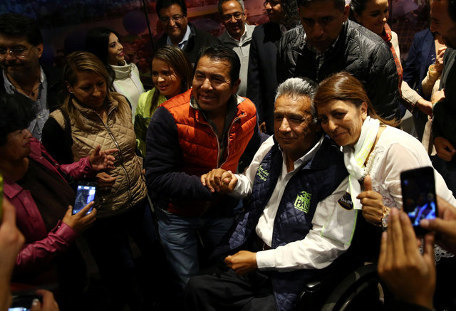 Lenin Moreno, presidential candidate of the ruling PAIS alliance party, is greeted by supporters after a news conference in Quito, Ecuador, February 20, 2017. Credit: Reuters