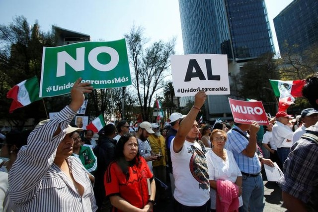 "Demonstrators hold placards that collectively read ""No wall"" during a march to protest against US President Donald Trump's proposed border wall, and to call for unity, in Mexico City, Mexico, February 12, 2017. Credit: Reuters"