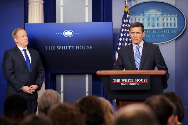 National security adviser General Michael Flynn (R) delivers a statement next to Press Secretary Sean Spicer during the daily briefing at the White House in Washington U.S., February 1, 2017.  Credit: Reuters