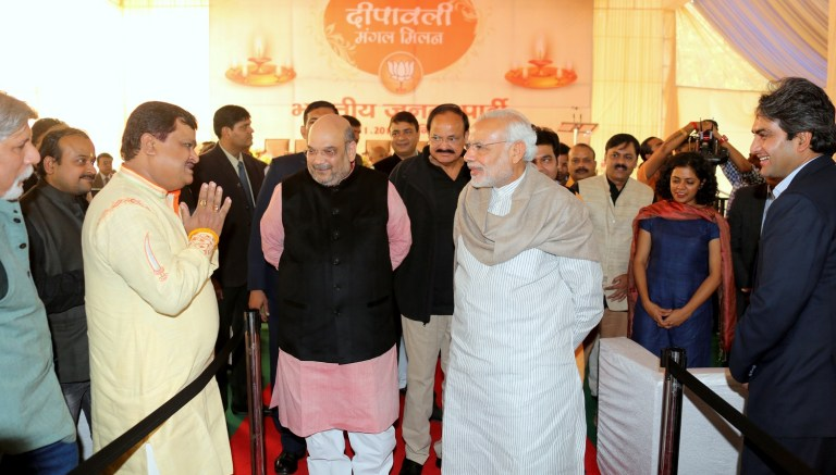 File photo of Prime Minister Narendra Modi and BJP president Amit Shah interacting with journalists at a Diwali function at the BJP office in Delhi. Source: www.bjp.org