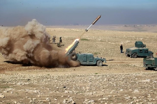 Members of the Iraqi rapid response forces fire a missile toward ISIS militants during a battle in south of Mosul, Iraq February 19, 2017. Credit: Reuters