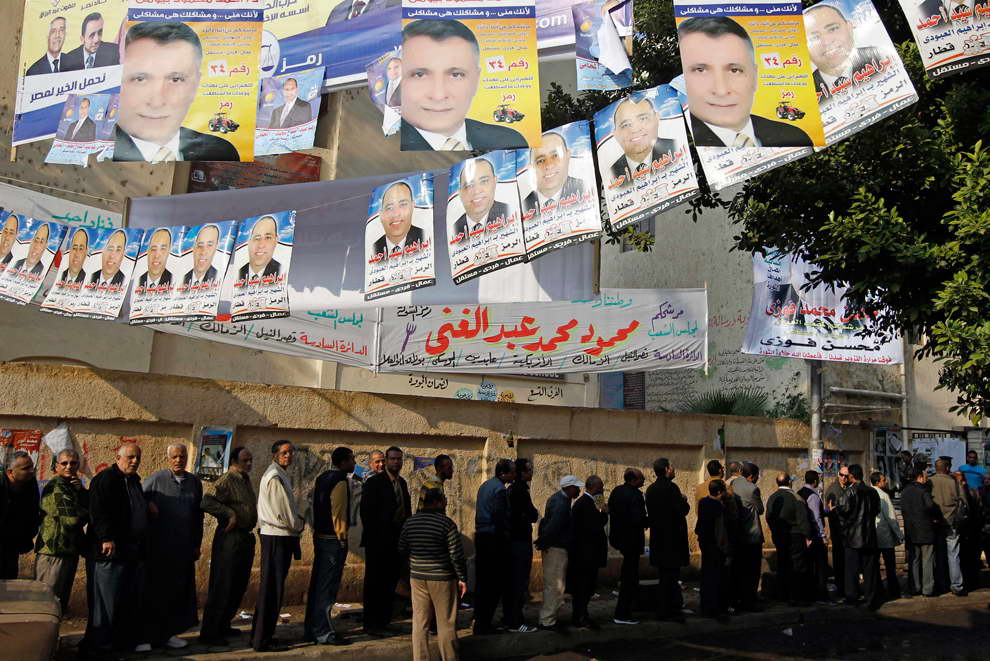 People line up at a polling station as they wait to cast their votes during parliamentary elections in Cairo Nov. 28. (Amr Abdallah Dalsh/Reuters)