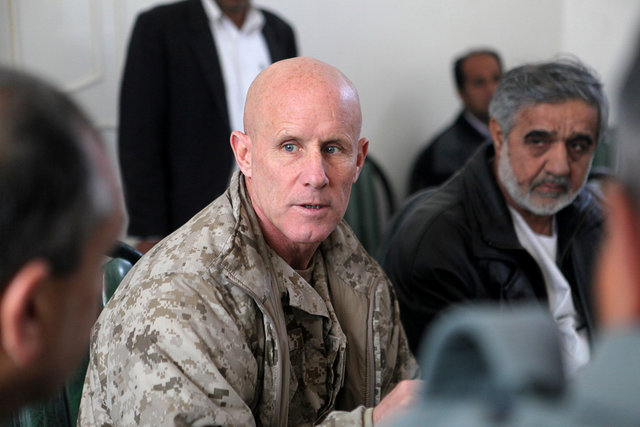 Vice admiral Robert S. Harward, commanding officer of Combined Joint Interagency Task Force 435, speaks to an Afghan official during his visit to Zaranj, Afghanistan, in this January 6, 2011 handout photo. The visit consisted of a tour of a provincial prison, the Iran/Afghanistan border crossing and an airfield assessment.  Sgt. Shawn Coolman/US Marines. Credit: Reuters