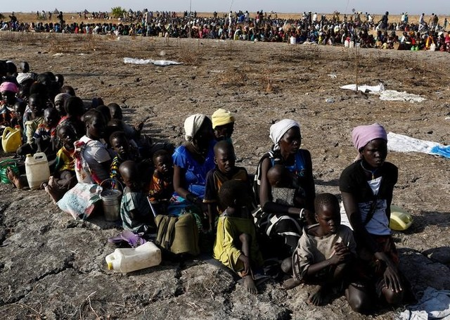 Women and children wait to be registered prior to a food distribution carried out by the UN World Food Program (WFP) in Thonyor, Leer state, South Sudan, February 26, 2017. Credit: Reuters