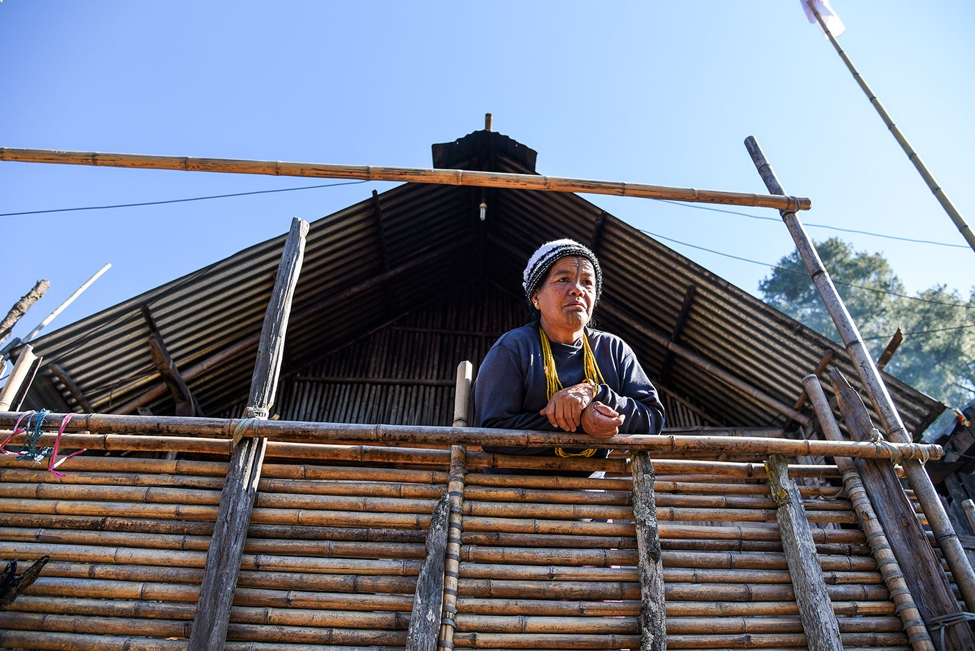 Narang Yamang, the community worker (gamburi in the Apatani language), wears strings of traditional beads around her neck