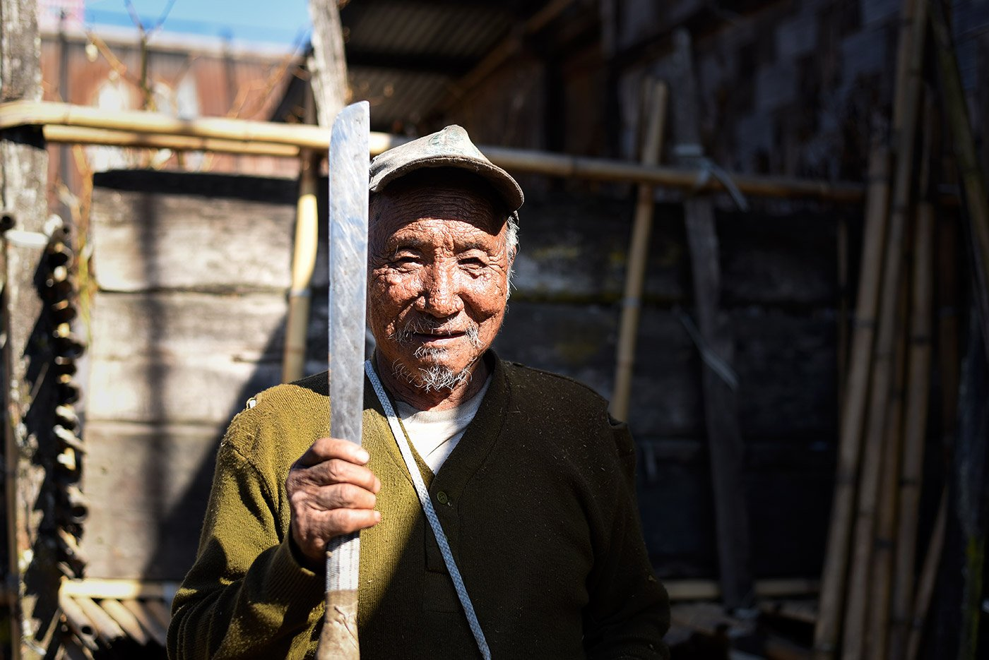 Tallo Tani displays a traditional sword, carried by every male of the Apatani community. Each family has 8-10 such swords, which are given to their sons-in-law as dowry.