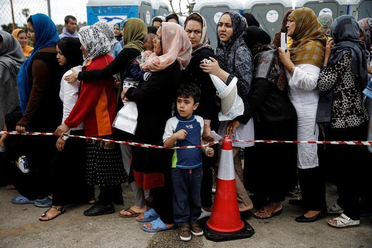 Migrants line up to receive personal hygiene goods distributed by the United Nations High Commissioner for Refugees. Credit: Reuters/Alkis Konstantinidis/Files