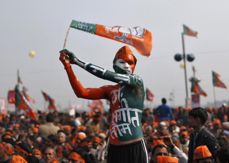 A supporter of India's main opposition Bharatiya Janata Party (BJP) waves the party's flag during a rally being addressed by Gujarat's Chief Minister and Hindu nationalist Narendra Modi, the prime ministerial candidate for BJP, ahead of the 2014 general elections, at Meerut in the northern A supporter of Bharatiya Janata Party (BJP) waves the party's flag during a rally. Credit: Reuters/Ahmad Masood