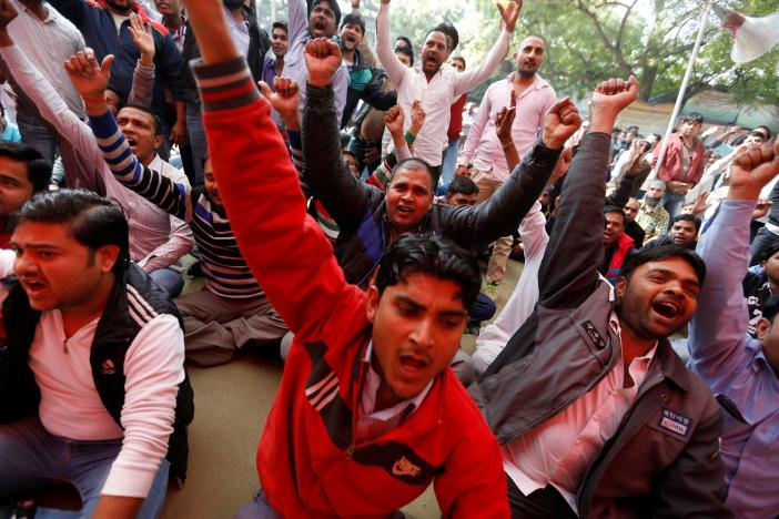 Uber and Ola drivers shout slogans during a protest in New Delhi. Credit: Reuters
