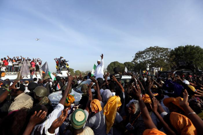 Gambia's President Adama Barrow, who was sworn in at the Gambian embassy in neighbouring Senegal, greets his supporters upon his arrival from Dakar, in Banjul, Gambia January 26, 2017. Credit: Reuters/Afolabi Sotunde