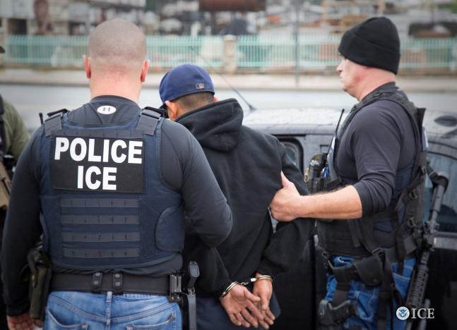 US Immigration and Customs Enforcement (ICE) officers detain a suspect as they conduct a targeted enforcement operation in Los Angeles, California, US, on February 7, 2017. Credit: Reuters