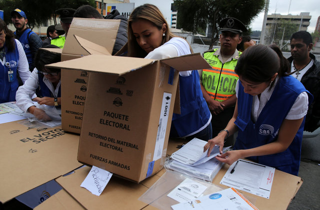 Workers of the Electoral National Council prepare electoral materials during a program for people with disabilities to vote in advance in the Sunday's presidential election, in Quito, Ecuador, February 17, 2017. Credit: Reuters
