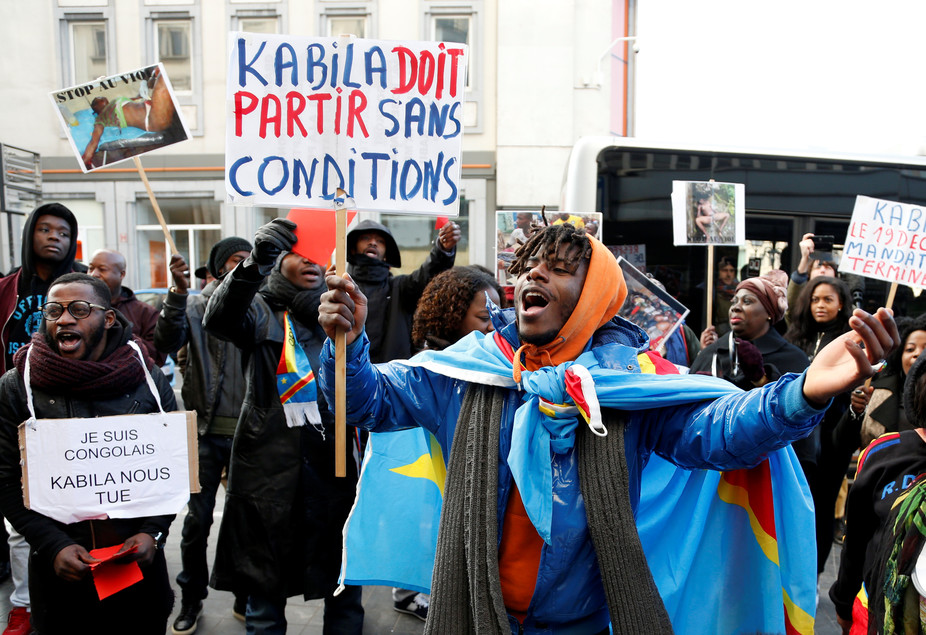 "A protest against President Joseph Kabila. The poster reads: ""Kabila must leave without any conditions"". Reuters/Francois Lenoir"