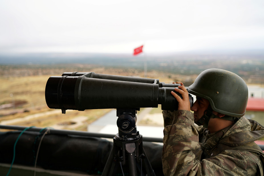 A Turkish soldier watches the border line between Turkey and Syria near the southeastern village of Besarslan, in Hatay province, Turkey. Credit: Reuters/Umit Bektas