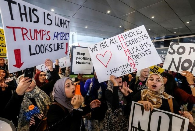 Demonstrators against the immigration rules implemented by US President Donald Trump's administration, rally at Los Angeles international airport in Los Angeles, California, US, February 4, 2017. Credit: Reuters