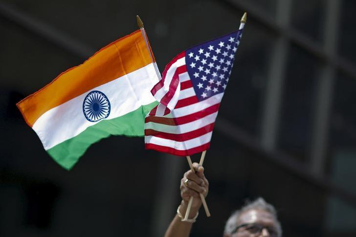 A man holds the flags of India and the US. Credit: Reuters/Eduardo Munoz/Files