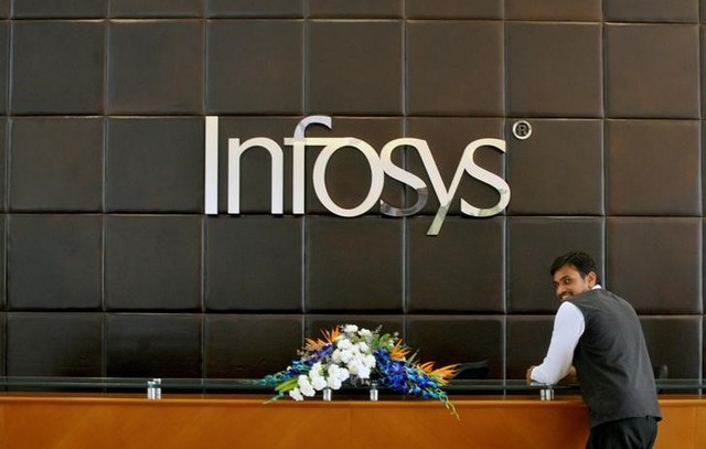 An employee of Infosys stands at the front desk of its headquarters in Bengaluru, India, April 15, 2016. Credit: Reuters