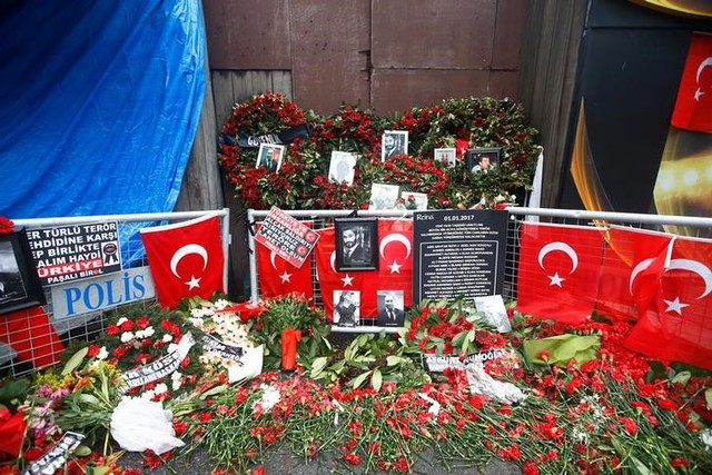 Flowers and pictures of the victims are placed near the entrance of Reina nightclub in Istanbul, Turkey, January 17, 2017. Credit: Reuters
