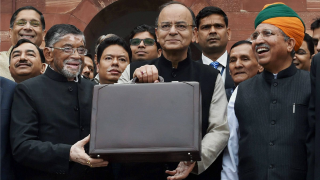 Finance minister Arun Jaitley (centre) stands outside his office at North Block holding the briefcase containing the Union Budget for 2017. Credit: PTI