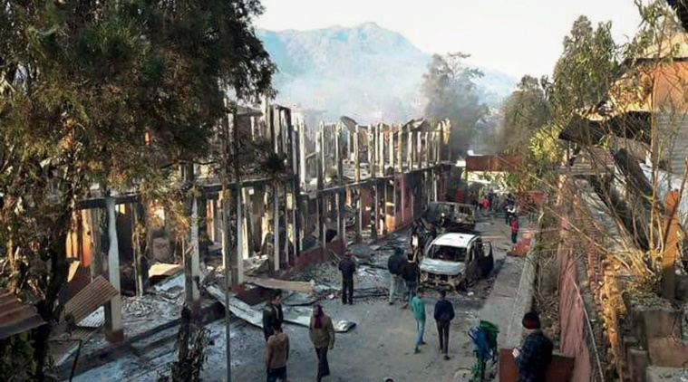 Naga tribals set ablaze the Kohima Municipal Council office and the office of the district collector during their violent protest, in Kohima on Friday. PTI Photo (PTI2_3_2017_000276B)