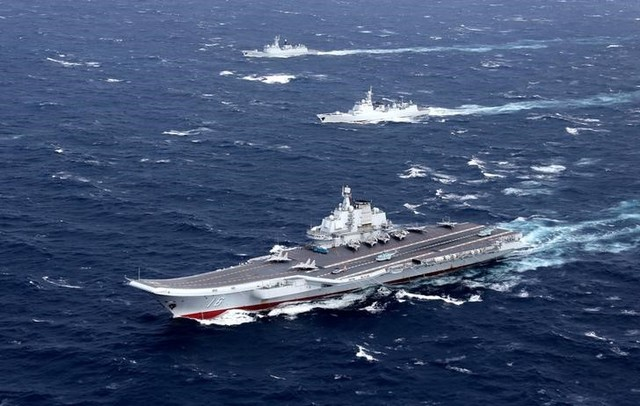 China's Liaoning aircraft carrier with accompanying fleet conducts a drill in an area of South China Sea, in this undated photo taken December, 2016. Credit: Reuters