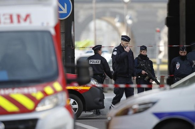 French police and emergency services are seen at the site near the Louvre Pyramid in Paris, France, February 3, 2017 after a French soldier shot and wounded a man armed with a machete and carrying two bags on his back as he tried to enter the Paris Louvre museum. Credit: Reuters