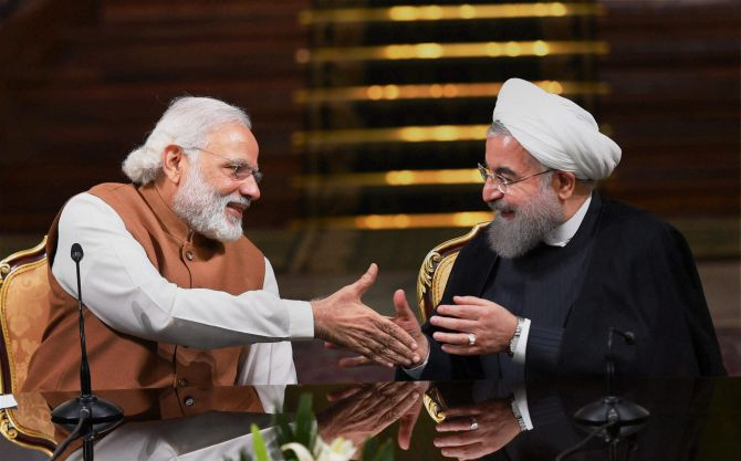 Prime Minister Narendra Modi shakes hands with Iranian President Hassan Rouhan. Credit: PTI