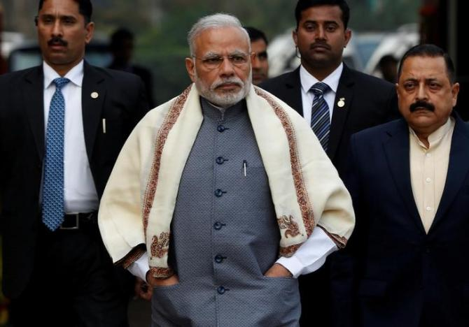 Prime Minister Narendra Modi walks to speak with the media as he arrives at the parliament house to attend the first day of the budget session, in New Delhi, India, January 31, 2017. REUTERS/Adnan Abidi/File Photo