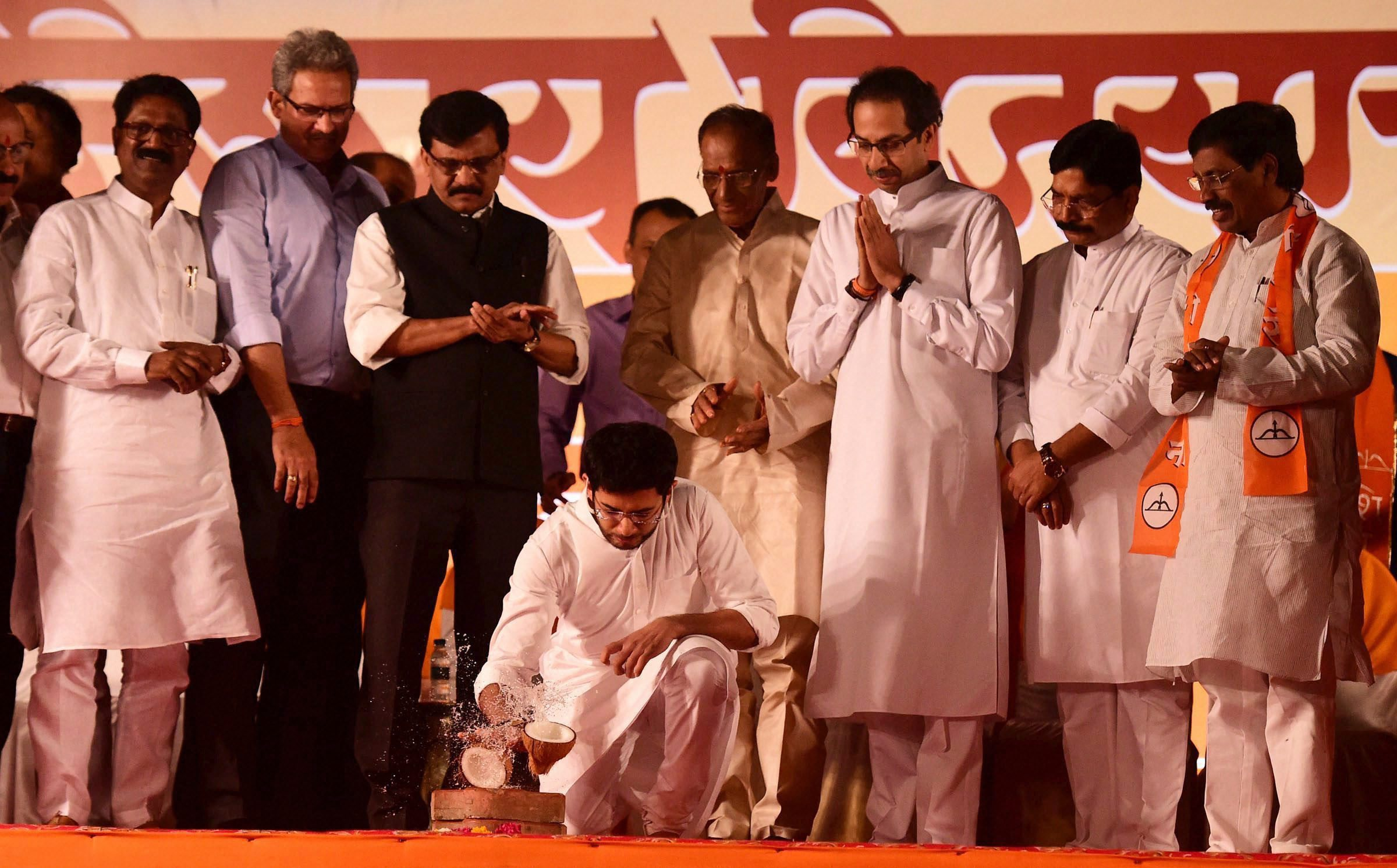 Mumbai: Shiv Sena president Uddhav Thackeray with son Aditya Thackeray and other leaders during the first rally for the Brihanmumbai Municipal Corporation (BMC) polls in Mumbai on Saturday. PTI Photo by Santosh Hirlekar(PTI2_4_2017_000250A)