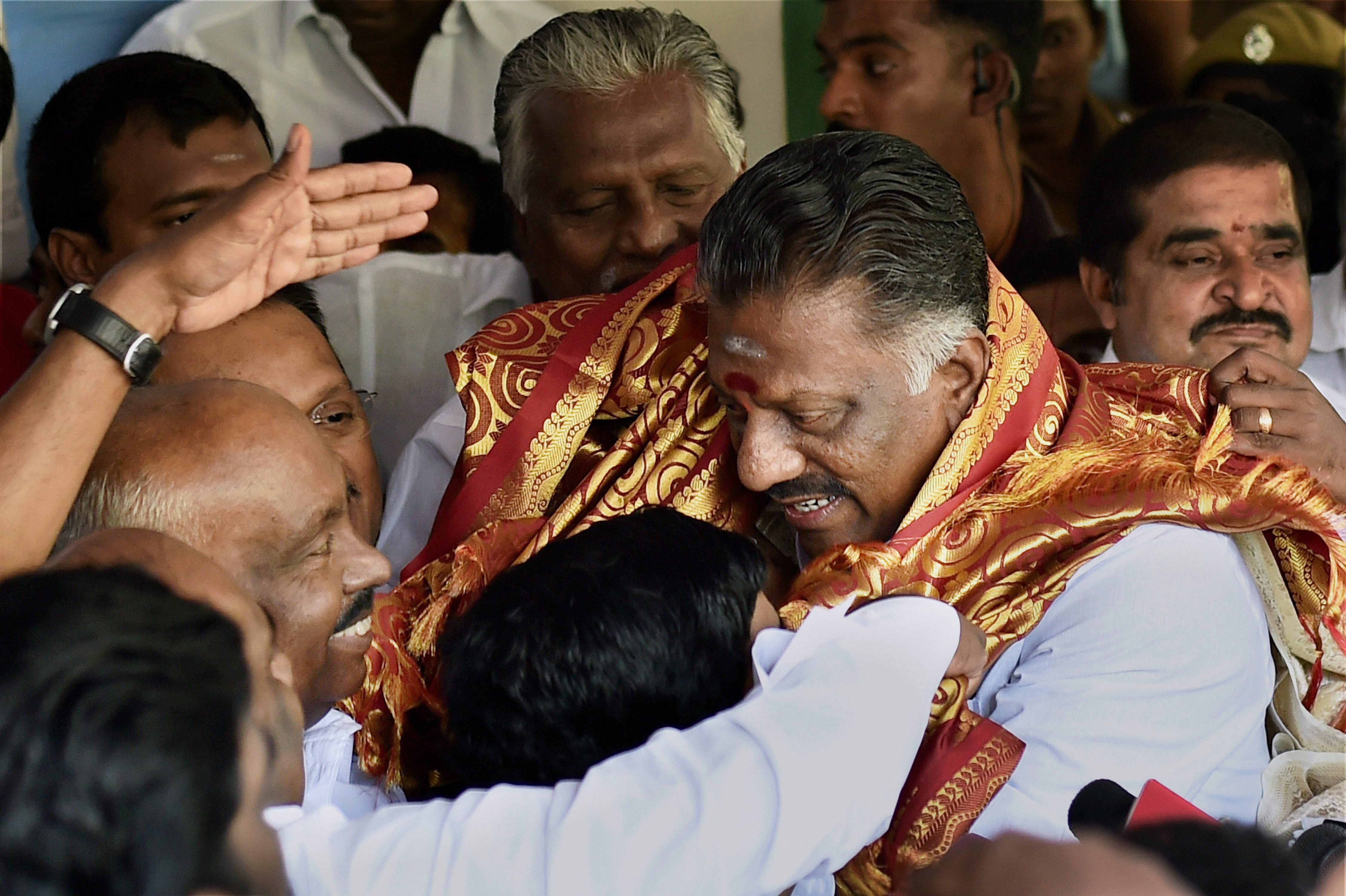 Tamil Nadu Chief Minister O. Panneerselvam being greeted by AIADMK founding leader and former speaker of the state assembly P.H. Pandian at his residence in Chennai on Wednesday. Credit: PTI/R. Senthil Kumar
