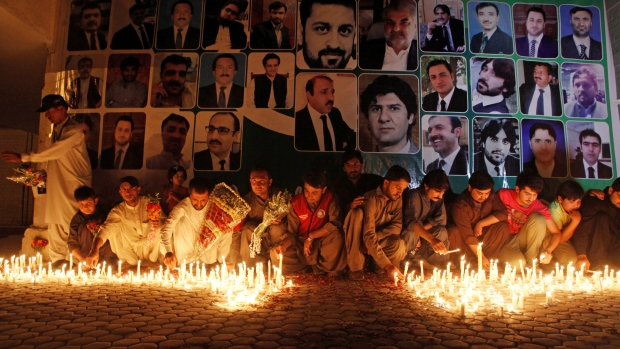 Residents light candles for lawyers killed during the Monday blast at Civil Hospital during a candle light vigil in Quetta. Residents light candles for lawyers killed during the Monday blast at Civil Hospital during a candle light vigil in Quetta. Credit:Naseer Ahmed/Reuters