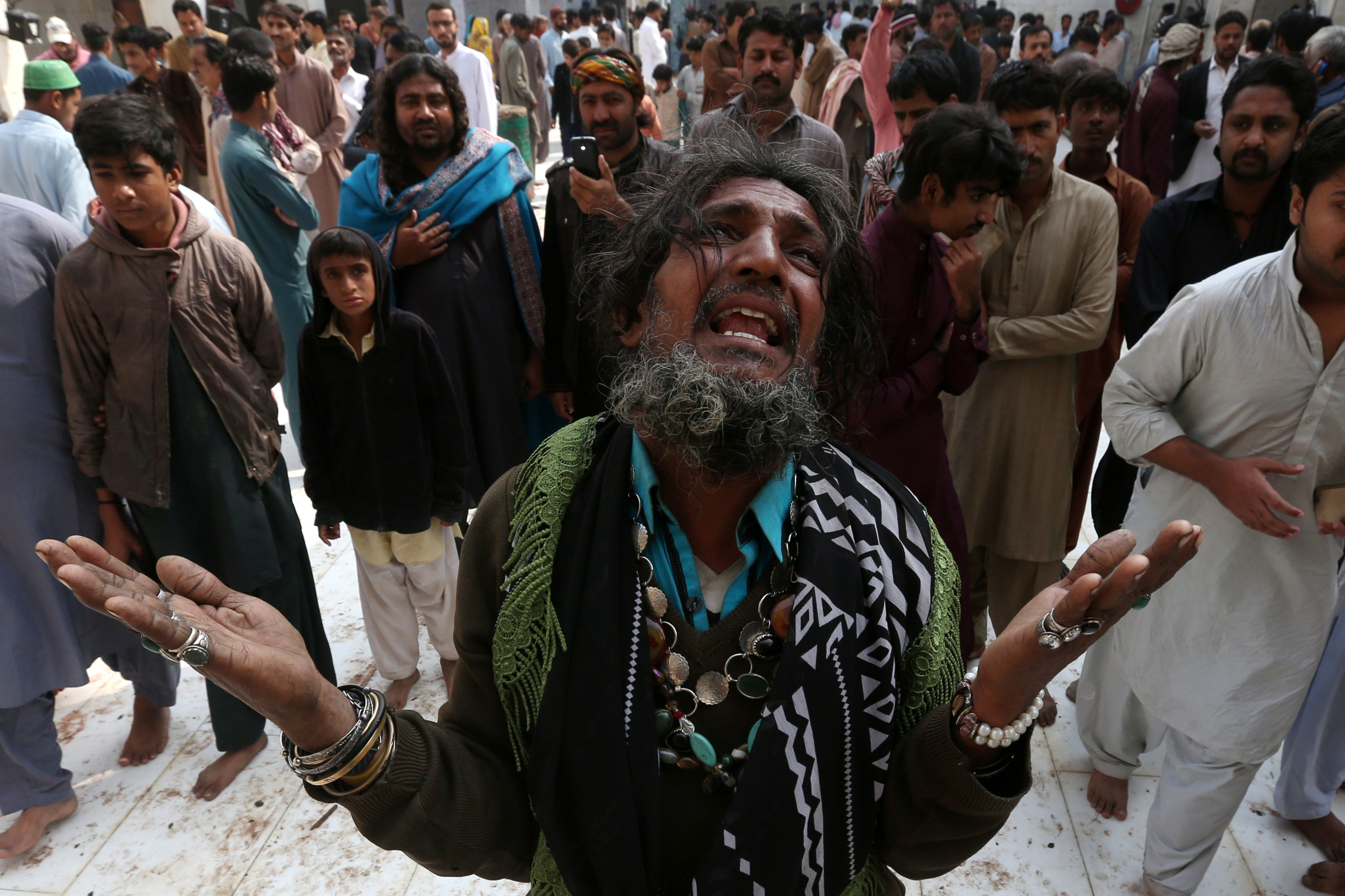 A man mourns the death of a relative who was killed in a suicide blast at the tomb of Sufi saint Syed Usman Marwandi, also known as the Lal Shahbaz Qalandar shrine, on Thursday evening in Sehwan Sharif, Pakistan's southern Sindh province, February 17, 2017. Credit: REUTERS/Akhtar Soomro