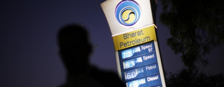 A Bharat Petroleum oil pump station as a pedestrian walks past in New Delhi. Credit: Reuters/Adnan Abidi/Files