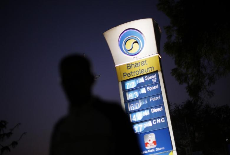 A Bharat Petroleum oil pump station as a pedestrian walks past in New Delhi. Credit: Reuters/Adnan Abidi/Files