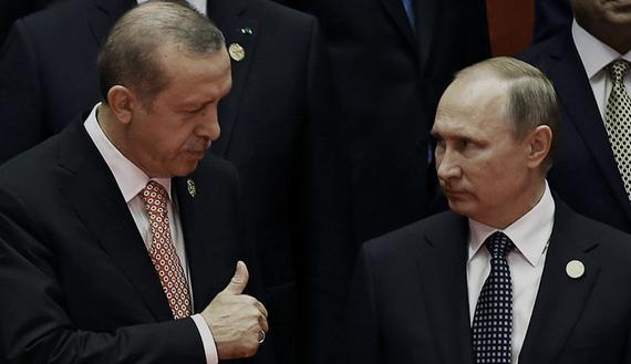 Russia's President Vladimir Putin interacts with Turkey's President Tayyip Erdogan. Credit: Reuters/Damir Sagolj