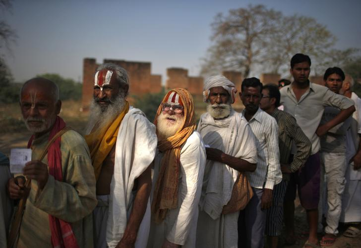 People including Sadhus or Hindu holy men line up to cast their vote outside a polling station in Vrindavan in the northern Indian state of Uttar Pradesh April 24, 2014. Credit: Reuters/Files