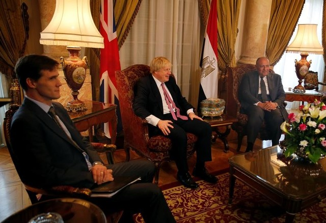 Egyptian foreign minister Sameh Shoukry (R) meets with British foreign secretary Boris Johnson (C) at Tahrir Palace in Cairo, Egypt February 25, 2017. Credit: Reuters