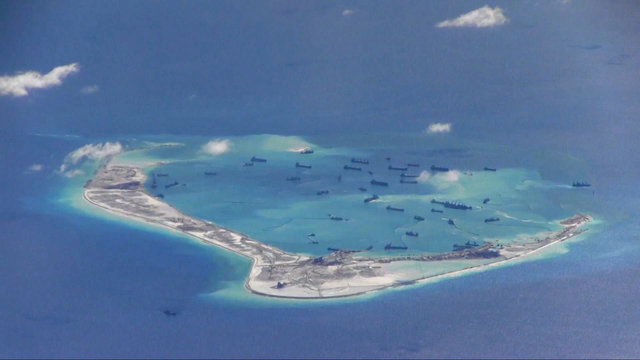 Chinese dredging vessels are purportedly seen in the waters around Mischief Reef in the disputed Spratly islands in the South China Sea in this still image from video taken by a P-8A Poseidon surveillance aircraft provided by the US navy May 21, 2015. US navy. Credit: Reuters