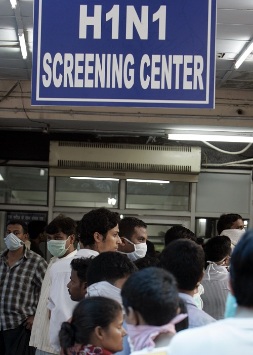 File photo of people waiting in a queue for a H1N1 flu screening. Credit: Reuters