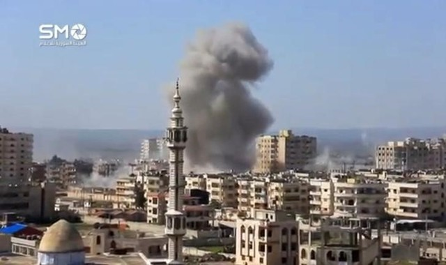 A still image taken from a video uploaded to a social media website, on February 25, 2017, purports to show air strikes in the rebel-held al-Waer area of Homs, Syria. Credit: Reuters