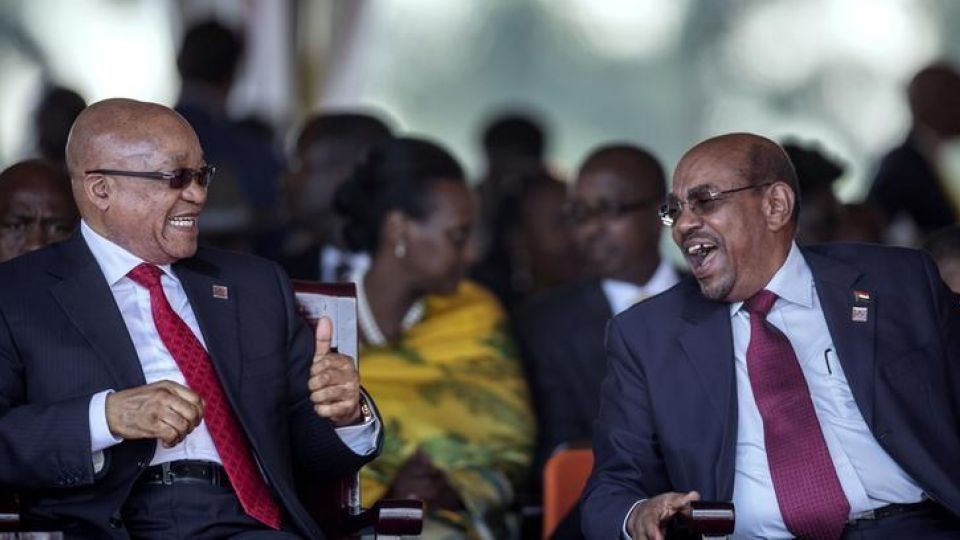 South African President Jacob Zuma shares a laugh with Sudanese President Omar al-Bashir (right) who is wanted by the International Criminal Court. Credit: Reuters/Files