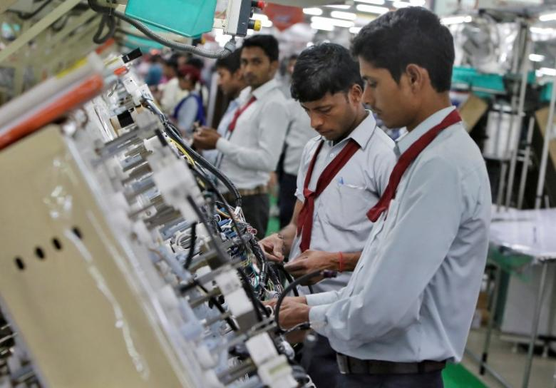 Employees of Motherson Sumi Systems Limited, work on a car wiring assembly line inside a factory in Noida on the outskirts of New Delhi, India April 28, 2016. Image for representation only. Credit: Reuters/Anindito Mukherjee/File Photo