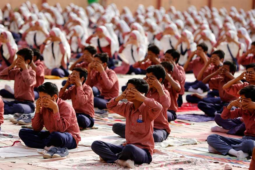 Students practice yoga during a training session ahead of International Yoga Day. Credit: Reuters