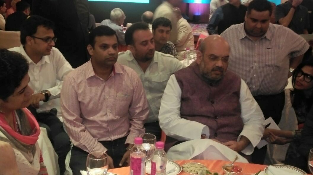 Dainik Jagran executive Tanmay Shankar and BJP president Amit Shah at the Vikas Parv event organised by the BJP to celebrate two years in power. New Delhi, May 2016. Credit: Tanmay Shankar's Facebook page.